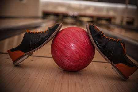 The bowling ball is ready to strike