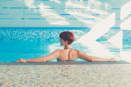 Young woman enjoys wellness and spa Stock Photo - 115161096
