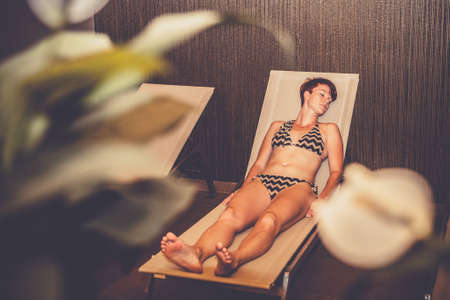 Young woman enjoys wellness and spa Stock Photo