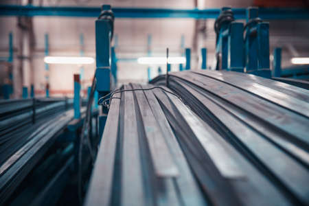 long and short steel pipes lay on shop rack Stock Photo