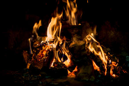 hot fire in darkness on fireplace on winter cottage Stock Photo - 115906709