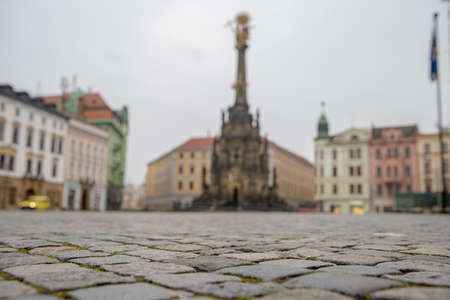 Holy Trinity Column in the main square of the old town of Olomouc, Czech Republic. Old cubes paving