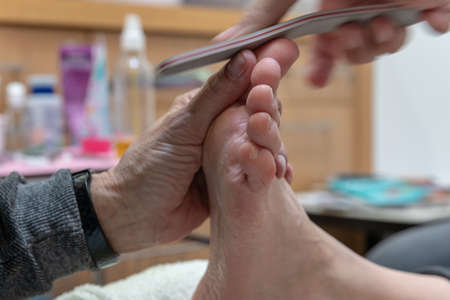 woman on pedicure and foot massage. Body care and relaxation for a healthy lifestyle