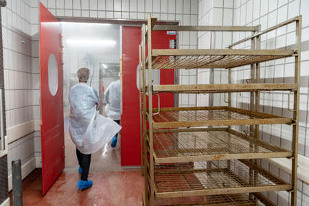 Production of meat products in the supermarket in the supermarket. Next, distribution of finished products to the stores shop for customers. Sausage, meatloaf, pate ...