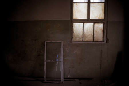 old dirty room in abandoned psychiatric hospital building. dirt and disorder on social facilities. broken window