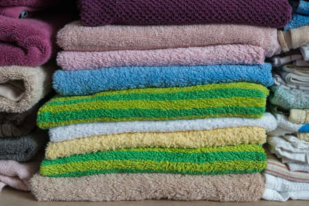 Stack of towels in the closet in bathroom Stock Photo