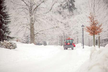 big tractor cleans road from snow in the winter. seasonal work 版權商用圖片