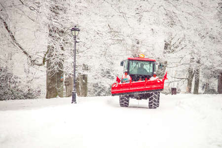 big tractor cleans road from snow in the winter. seasonal work