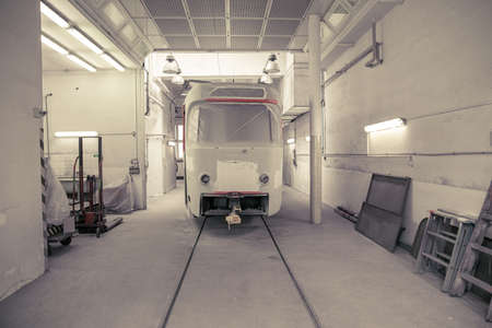 repair of tram in depot. garage equipped for service and repair of public transport
