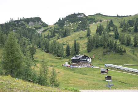 Beautiful nature of Austrian Alps in summer. Lake views, mountain huts and cows on the meadows