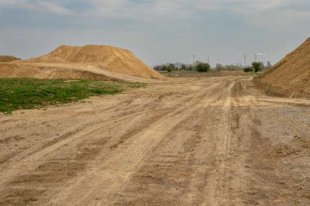 excavator summarizes soil on construction site in summer season