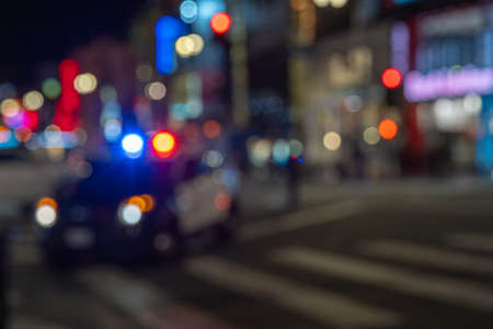 Police in an American city intervenes in a car accident. flashing highlights