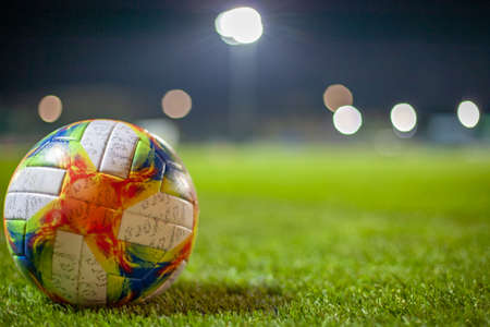Soccer ball on the pitch before the final match two teams