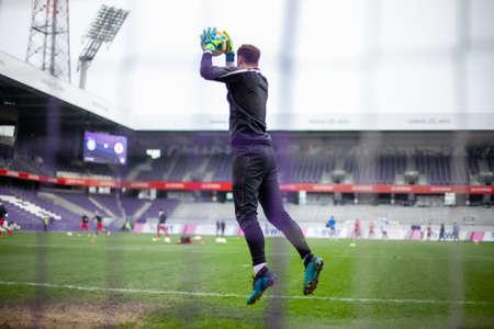 Goalkeeper catch the ball when defensive on goal during a football match Banco de Imagens