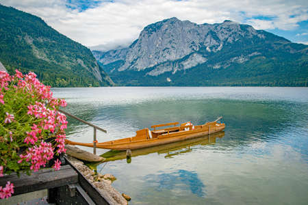 lake in the mountains in austrian alps in beautiful summer tourist season with blue sky and clear water