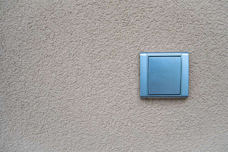 silver light switch on outdoor wall