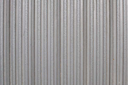 metal sheets next to each other form the foundation for a metal gate or fence. Structure for background or wallpaper