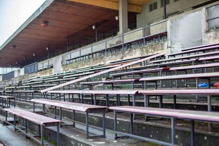 old stadium for a large number of spectators. Abandoned grandstands and buildings Foto de archivo