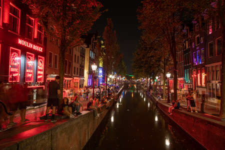 Amsterdam - August 27, 2019: nightlife in the streets of the capital of the Netherlands