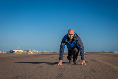 man running on the runway at the airport