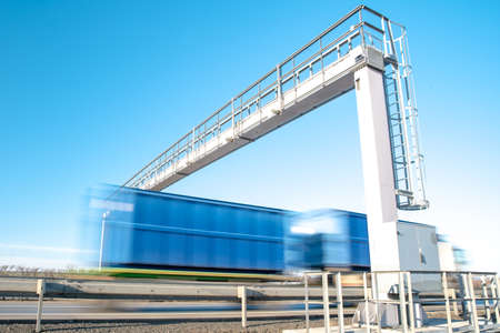 truck drive through the highway through the toll gate, toll charges, blurred motion in the image Stock Photo