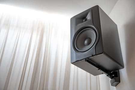 black speaker on the wall in the room for sound. Banque d'images