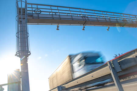 truck passing through a toll gate on a highway toll roads Stock Photo