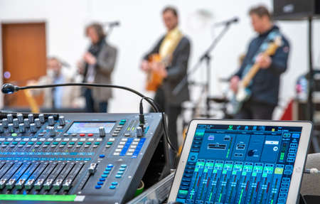 audio mixing console for controlling the sound of a music band at a concert.