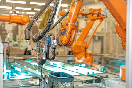 robotic arm for automated production of components for the automotive industry