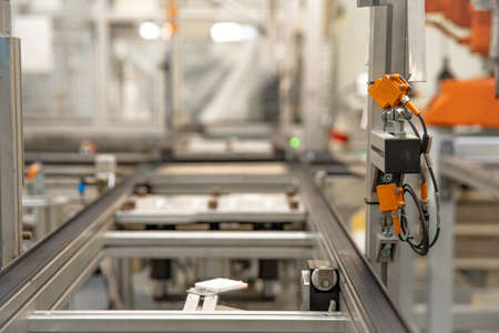 conveyance rail for products during machining automatically by robotic arms. Stockfoto