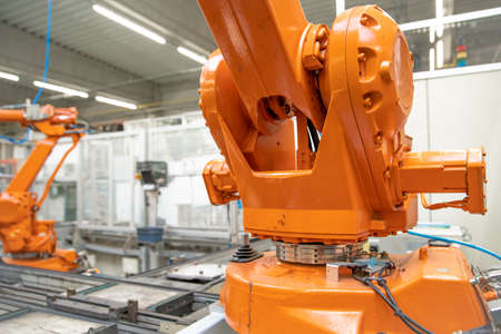 Detail of a robotic arm in a factory, auto industry Archivio Fotografico