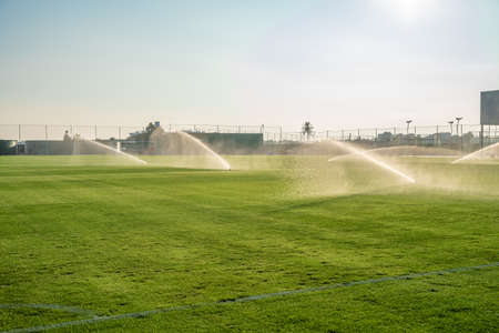 irrigation of the football field before the game
