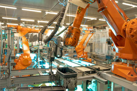 Detail of a robotic arm in a factory, auto industry Stock Photo