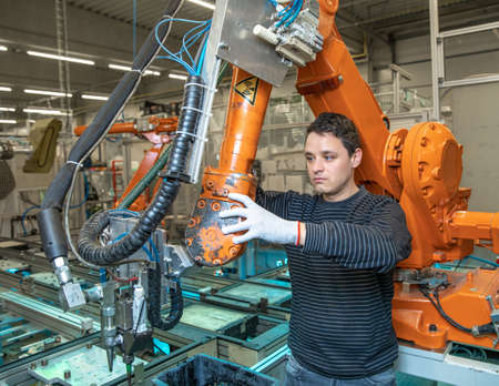 preparing a robot for the production of a new type of cars in the automotive industry