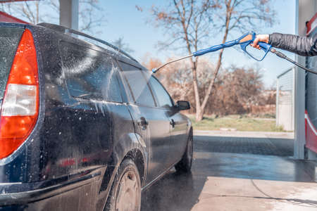 manual car wash by spraying treated water under high pressure.