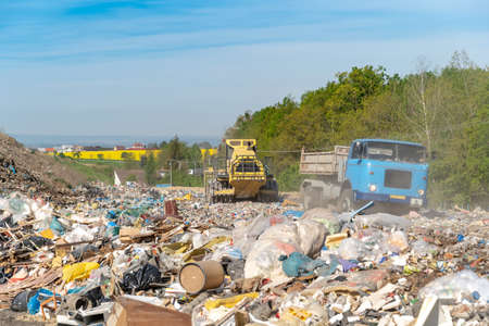 the car transports waste to a landfill for compactor processing and storage.