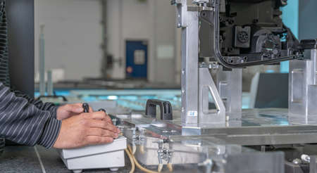 quality engineer controls an instrument for 3D measurement of plastic castings in the automotive industry
