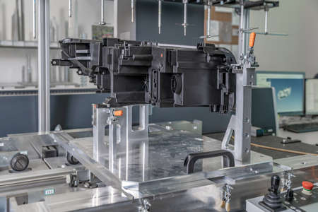 3D measuring device in a factory for the production of plastic castings for the automotive industry.