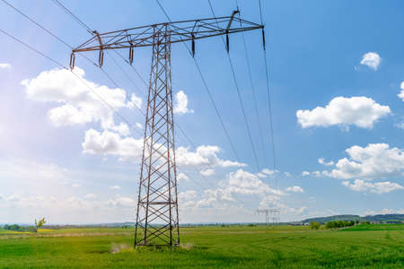 poles with high voltage wires in the country. Imagens - 148006441