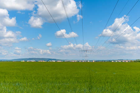 poles with high voltage wires in the country Imagens