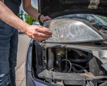 car headlight repair by replacing bad bulbs with new ones
