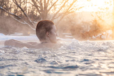 winter pool with a young attractive relaxing woman Standard-Bild