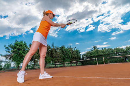 tennis serve by a young woman on the court
