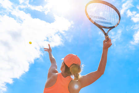 tennis serve by a young woman on the court. view from below Stockfoto - 161505822