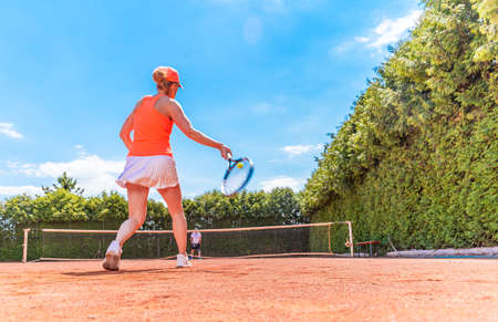 tennis game on a clay outdoor court