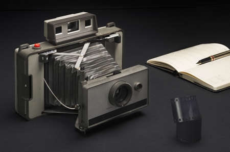 viewfinder vintage: An old camera with 35 millimeter film, fountain pen and diary