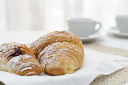 Two croissant with a cup of coffee photo
