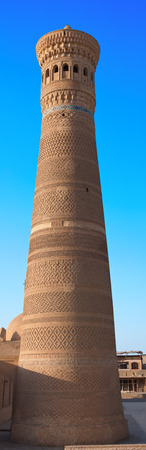 View from the south side on Kalyan minaret. This minaret also known as the Tower of Death is one of the most prominent landmarks in the Bukhara, Uzbekistan. Reklamní fotografie