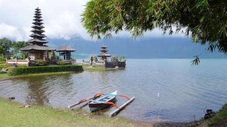 a boat near the ulun danu temple in bratan lake, bedugul, buleleng, bali photo