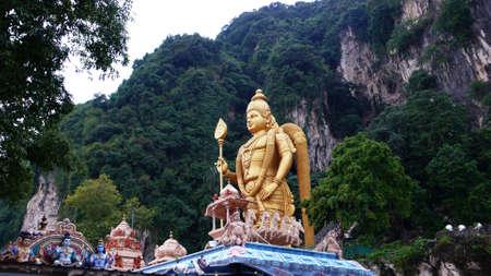 lord murugan statue at batu caves, malaysia photo